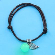LGB002-3 Черный браслет со светящейся бусиной из нефрита 14мм, цвет свечения сине-зеленый